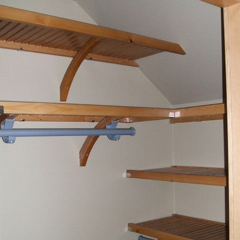 John Louis Home solid wood shelving system for angled ceilings.
