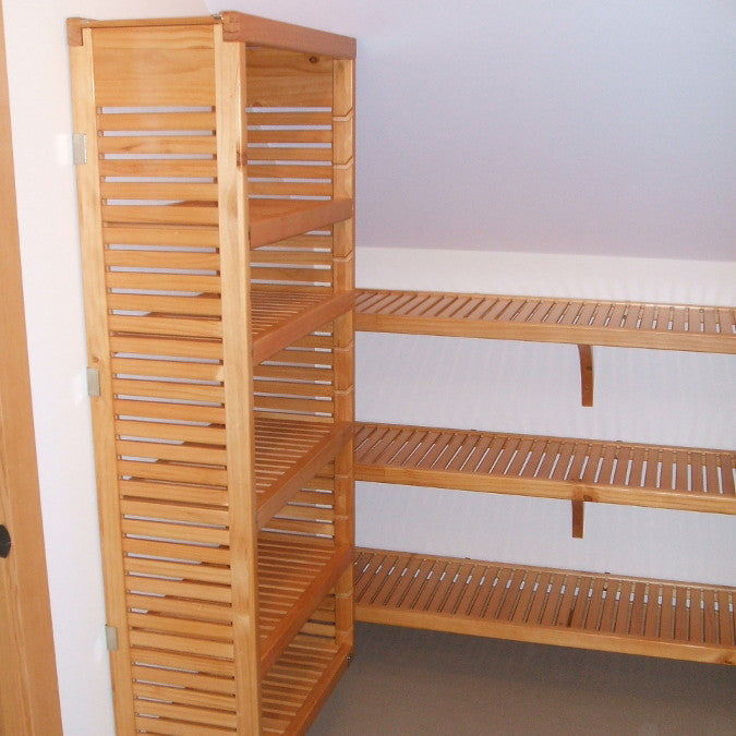 John Louis Home solid wood shelving design with shortened tower installed for low angled ceiling.