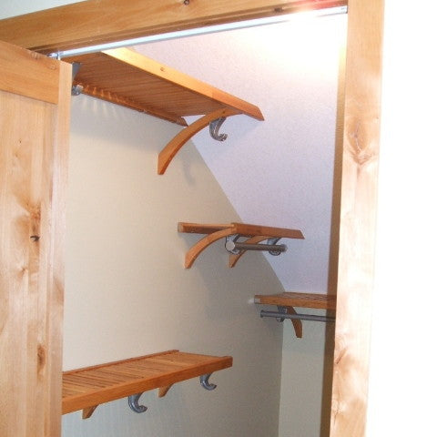 John Louis Home solid wood open ended shelving closet design for angled ceilings.
