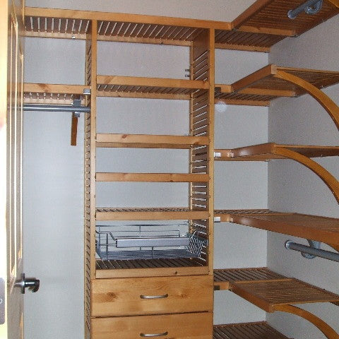 John Louis Home solid wood shelving system for bedroom closet.