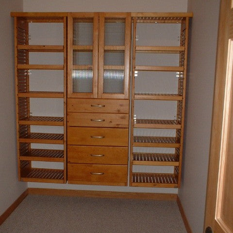 John Louis Home solid wooden closet system with 3 side by side towers.