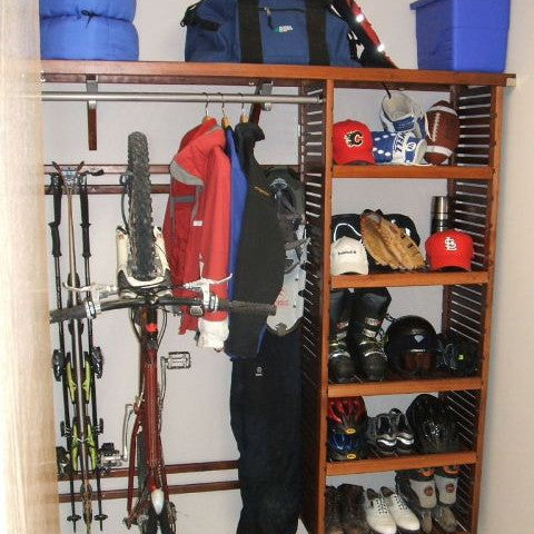 John Louis Home solid wood shelving closet design with bike and ski storage.