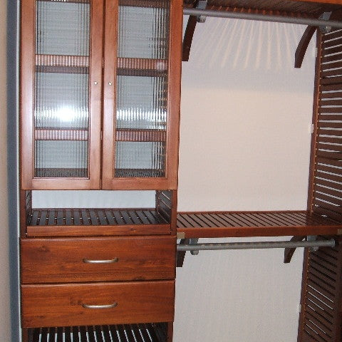 John Louis Home closet system with glass doors and drawers installed in tower.
