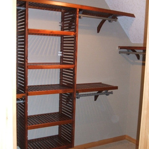 John Louis Home solid wood shelving closet design for angled ceiling.