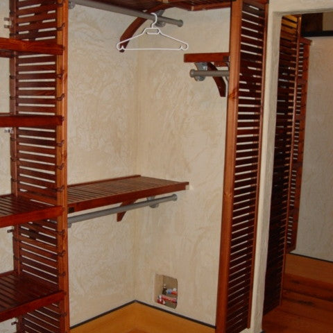 John Louis Home solid wood shelving design for bedroom closet including vertical shelf.