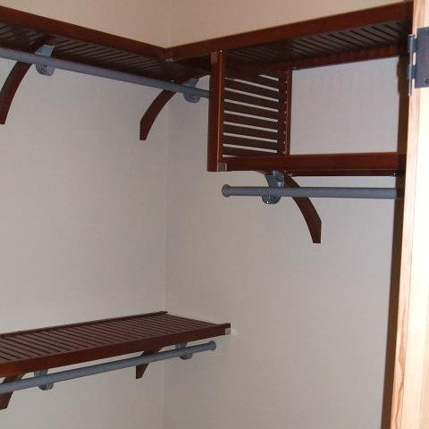 John Louis Home solid wood shelving closet design with vertical shelf.