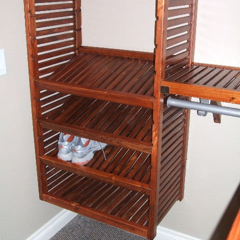 John Louis Home solid wood closet system with shoe shelf.