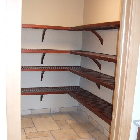 Red Mahogany John Louis Home closet solid wood shelving design in large, L-shaped kitchen pantry.