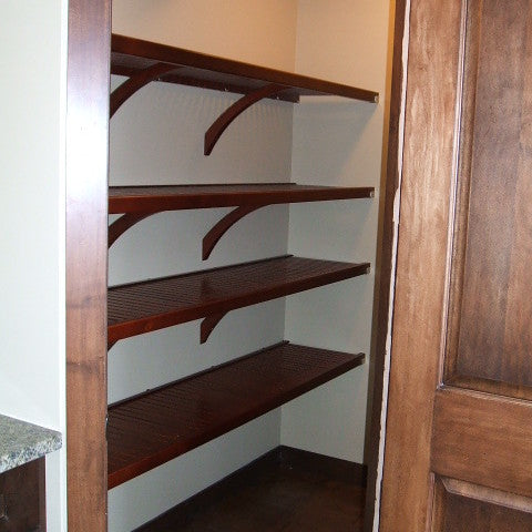 Four levels of Red Mahogany John Louis Home closet solid wood shelving design in wide kitchen pantry.