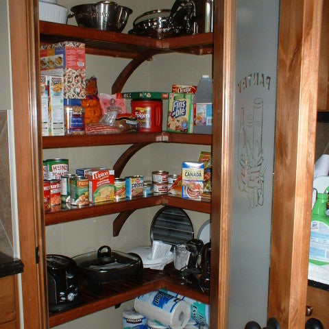 Red Mahogany John Louis Home closet solid wood shelving design in L-shaped kitchen pantry.