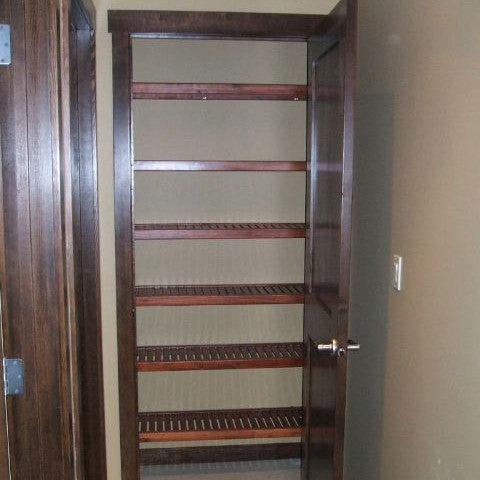 John Louis Home solid wood shelving design with 6 levels of shelving for linen closet.