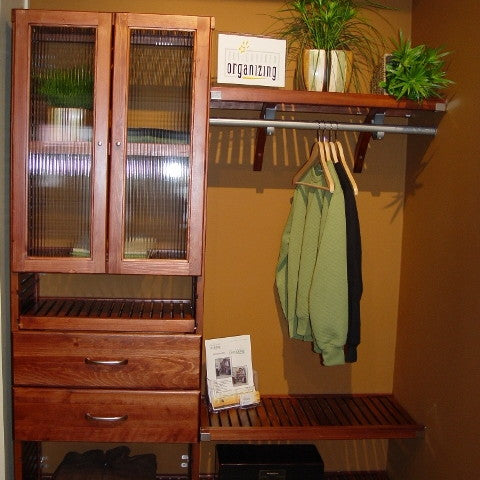 John Louis Home solid wood shelving closet design with tower including doors and drawers, additional shoe shelves below.