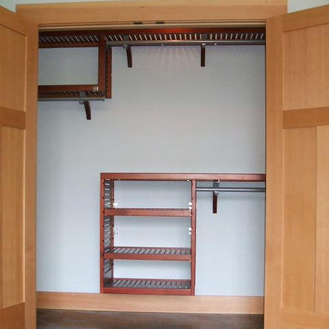 John Louis Home solid wood shelving closet design with shortened tower.