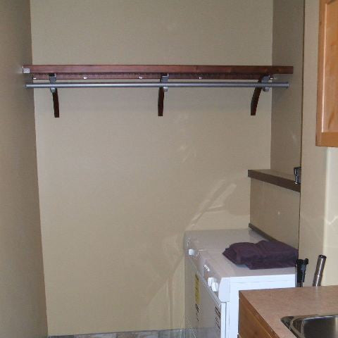 John Louis Home solid wood shelving design with long hang shelf and rod for laundry room.