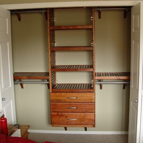 John Louis Home solid wood shelving design with drawers for bedroom closet.