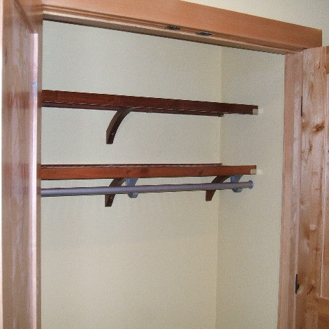 John Louis Home solid wood shelving closet design for bedroom including storage shelf.