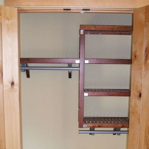 John Louis Home solid wood shelving design with fixed shelves for entry closet.