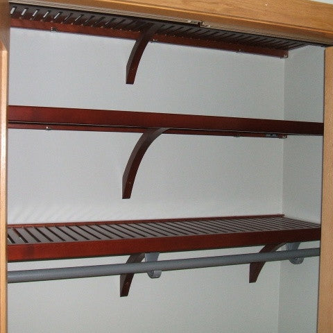 John Louis Home solid wood shelving design with fixed top shelves for bedroom closet.