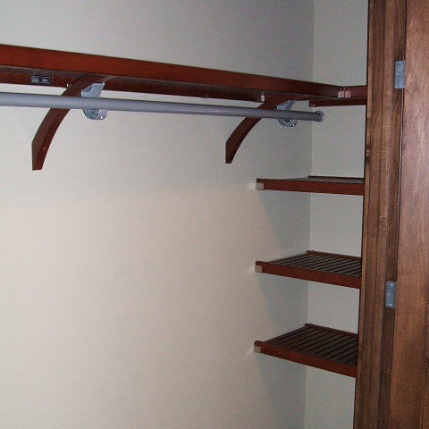 John Louis Home solid wood shelving design with fixed shelves for bedroom closet.