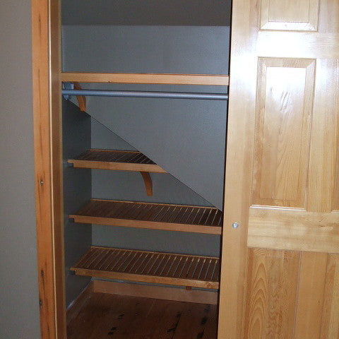 John Louis Home closet solid wood shelving design for under eaves and angled ceilings.