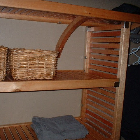 John Louis Home closet solid wood shelving design for linen closet.