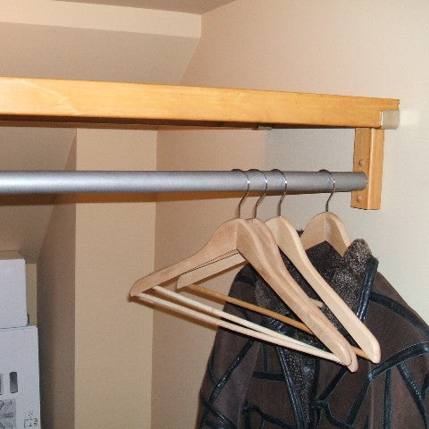 John Louis Home closet solid wood shelving design for extra storage under stairs.