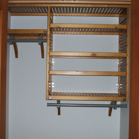John Louis Home closet solid wood shelving design with widened and shortened tower for entry closet.