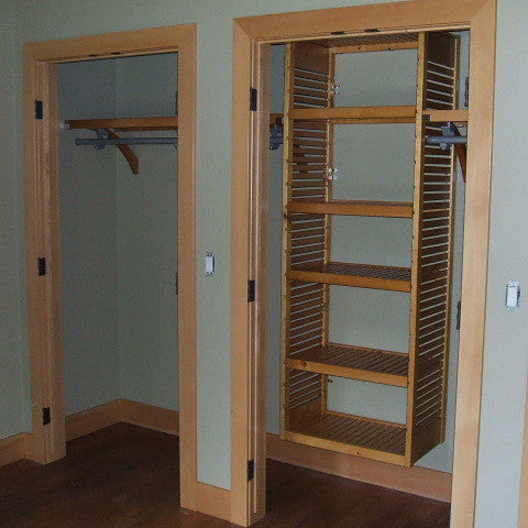 John Louis Home closet solid wood shelving design with tower for bedroom closet.