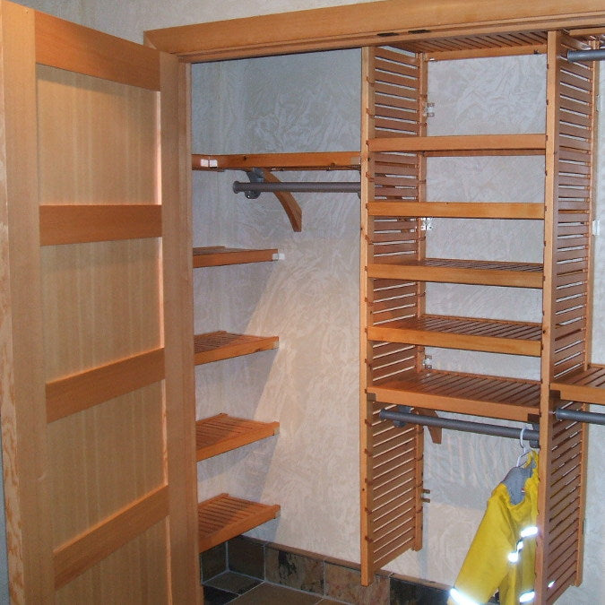 John Louis Home closet solid wood shelving design for entry closet.