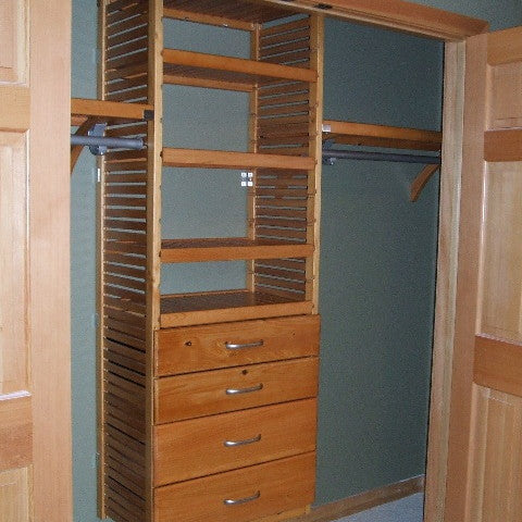 John Louis Home closet solid wood shelving design with tower and drawers for bedroom closet.