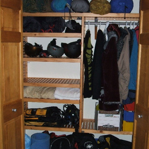John Louis Home closet solid wood shelving design with tower for mudroom closet.