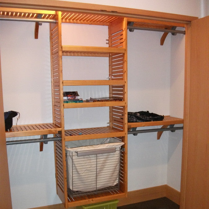 John Louis Home closet solid wood shelving design with laundry basket for bedroom closet.
