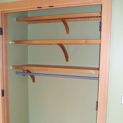 John Louis Home closet solid wood shelving design for bedroom closet.