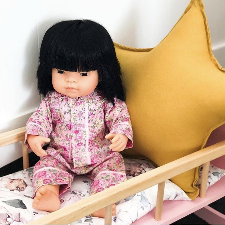 Miniland Asian 38cm doll in wooden crib with mustard yellow star cushion