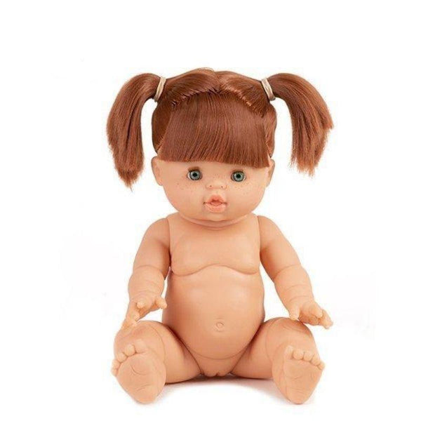 Red Head Minikane Baby Doll which is articulated and sitting down