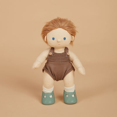 Olli Ella Dinkum Doll wearing basil green slip on doll's shoes
