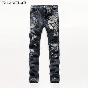 Open image in slideshow, European American Style men fashion jeans cotton luxury quality slim skulls brand Straight men hole jean black denim trousers