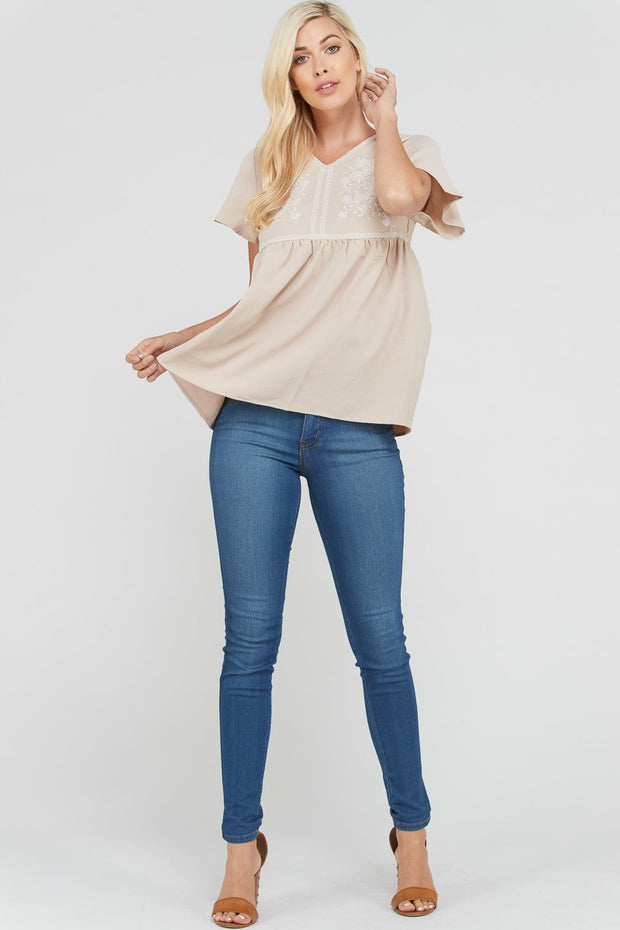 Taupe embroidery v-neck short sleeve top.