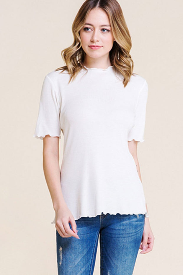 White mock neck basic top with merrow finished hem.