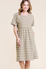 Olive colored short sleeve dress with pockets.