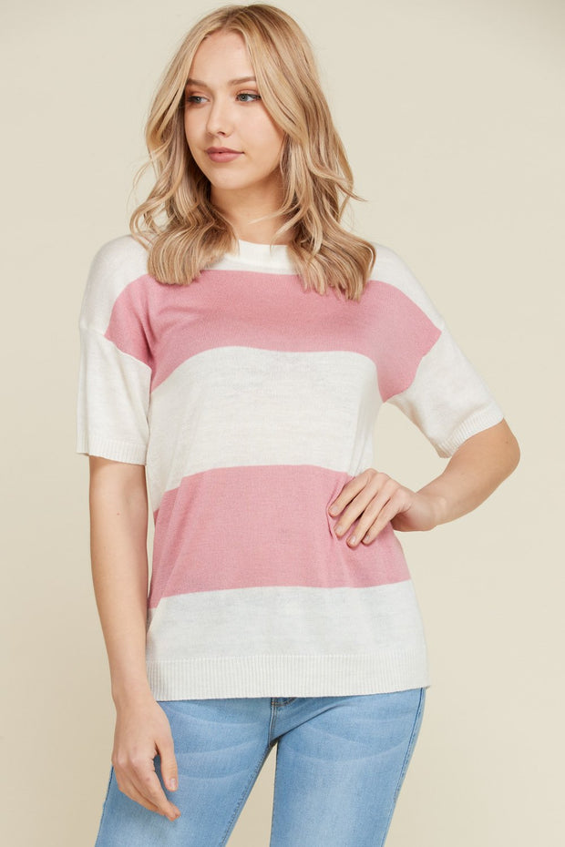 Pink and white short sleeve sweater top.