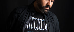 A Man With Beard Wearing Preciosa T-Shirt from Mad Coqui Apparel
