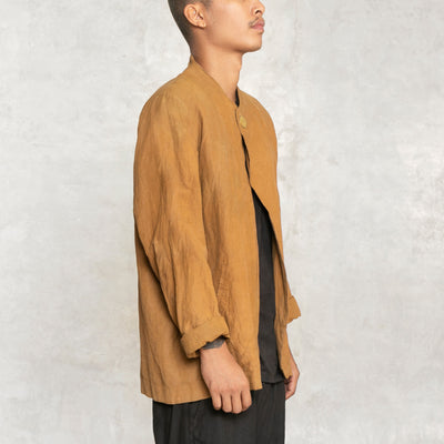 jacket with single button at neck