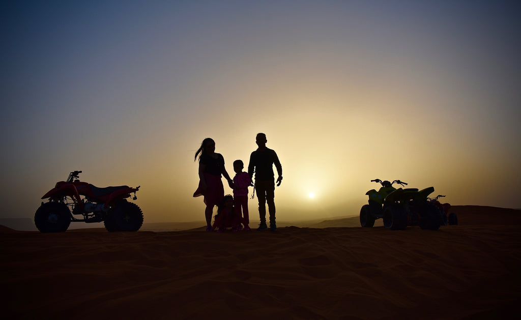 a-family-on-a-sunset-quad-bike-adventure