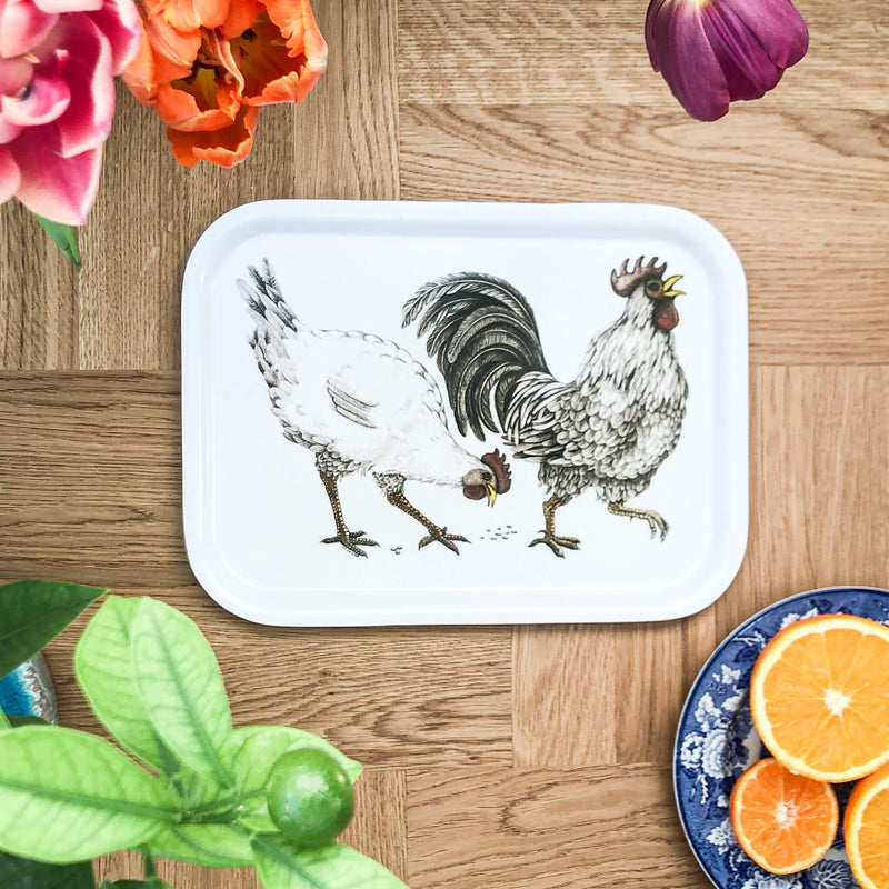 rooster and hen on wooden tray