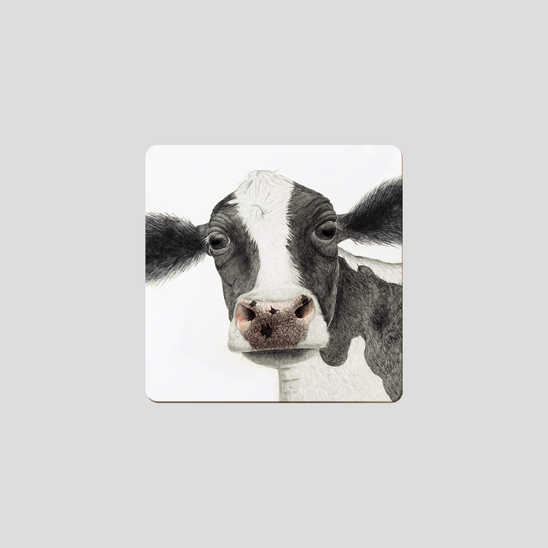 A black and white cow on a coaster - by Charlotte Nicolin