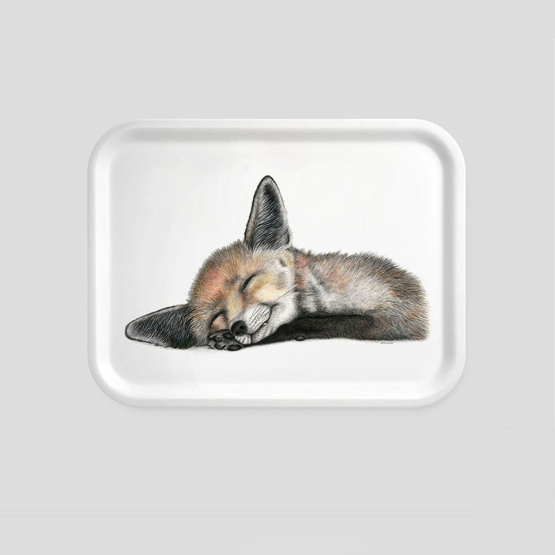 sleeping fox on a small wooden tray