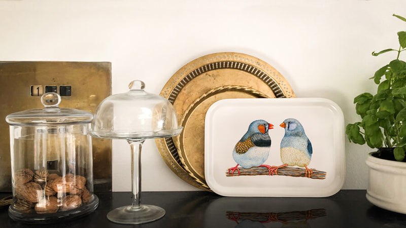 two birds holding hands tray