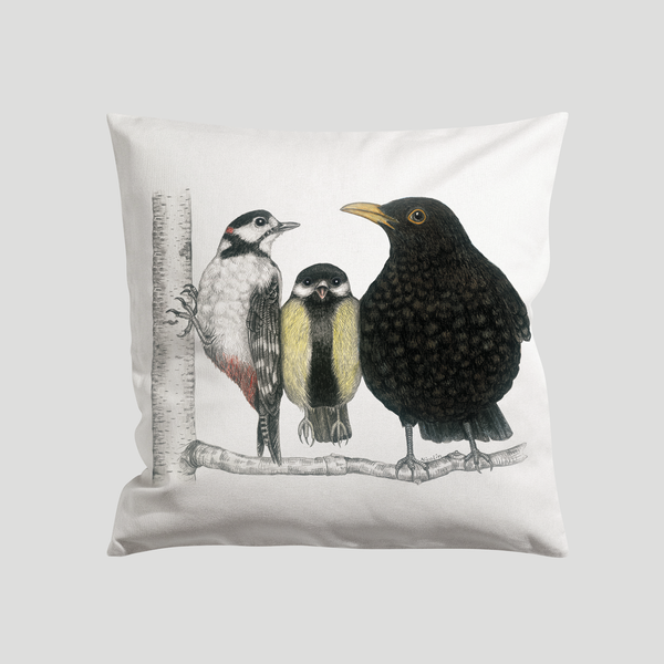 Black bird on a branch a art print on a cushion - by Charlotte Nicolin