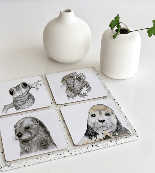 coasters with frog, seal and seaotter motifs